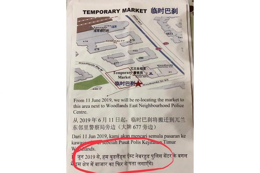 The flyers were meant to inform the public about the relocation of the market at Admiralty Place mall to a new area next to Woodlands East Neighbourhood Police Centre.