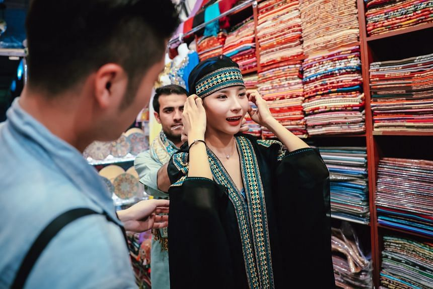 Pick fabric to be made into a blouse or a traditional outfit at the Textile Souk. PHOTO: NICO GUO