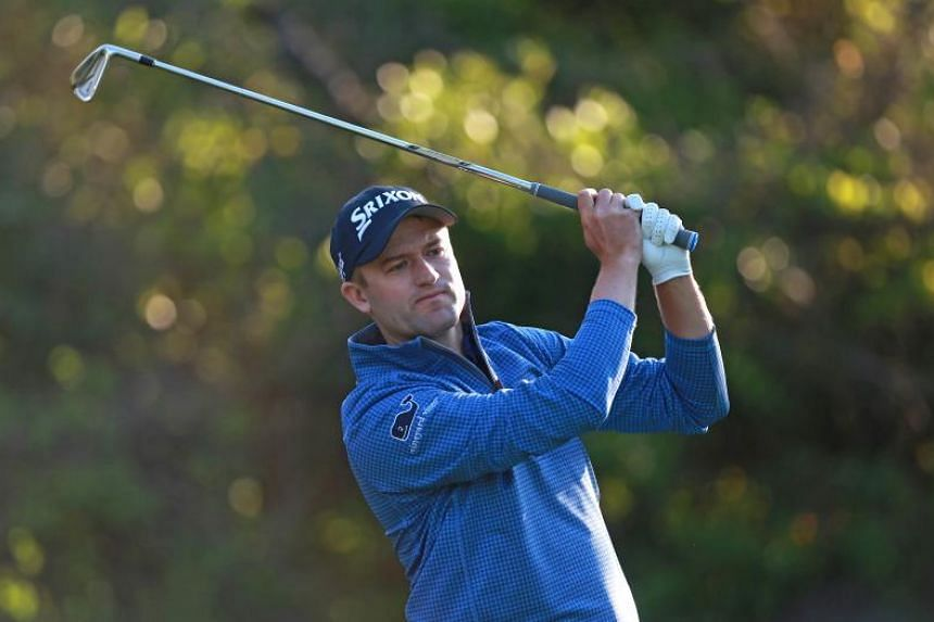 Casey shares early lead in title defence at Innisbrook
