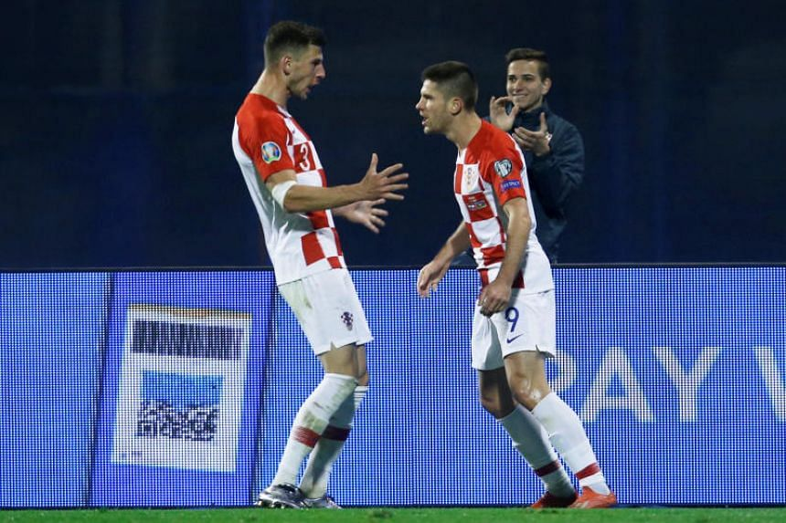 Croatia's Andrej Kramaric (right) celebrates scoring their second goal with Borna Barisic during their opening Euro 2020 Group E qualifier against Azerbaijan in Zagreb on March 21, 2019.