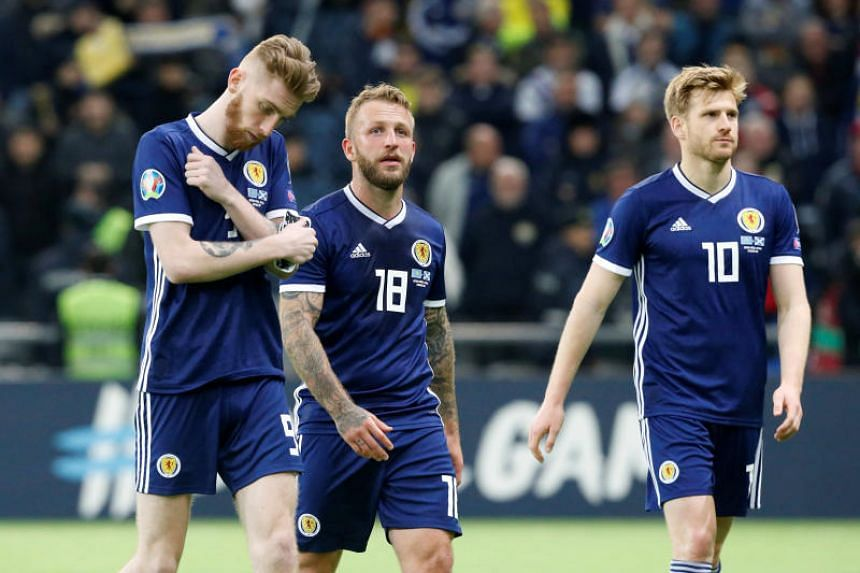 Scotland's (from left) Oliver McBurnie, Johnny Russell and Stuart Armstrong react after the 3-0 defeat by Kazakhstan in Nursultan on March 21, 2019.