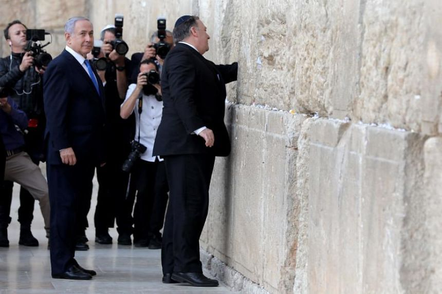 Israeli Prime Minister Benjamin Netanyahu stands by as US Secretary of State Mike Pompeo prays at the Western Wall in Jerusalem's Old City on March 21, 2019.
