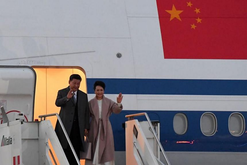 Mr Xi descended from his Air China Boeing 747 with first lady Peng Liyuan at Rome's Fiumicino airport before being whisked off to their hotel on March 21, 2019.