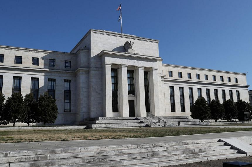 The Fed abandoned plans for any interest rate hikes this year amid signs of an economic slowdown, and said it would halt the steady decline of its balance sheet in September.