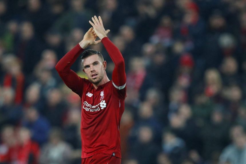 Liverpool's Jordan Henderson applauds the fans at the end of the Liverpool v Newcastle United match in Anfield, Liverpool, Britain, on Dec 26, 2018.