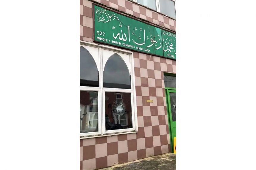 Damaged windows of a mosque are seen in Birmingham, Britain, on March 21, 2019, in this still image taken from a video obtained from social media.