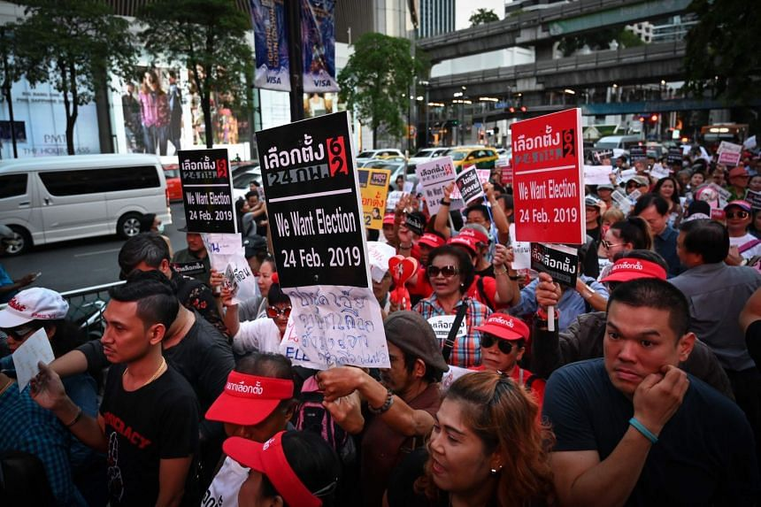 Thai anti-junta activists march during a demonstration against the possible delay of the country's general election, in Bangkok, on Jan 8, 2019.