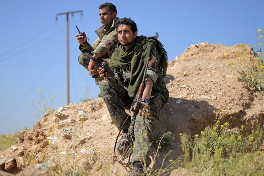 Backed Syrian fighters search tunnels in last IS pocket