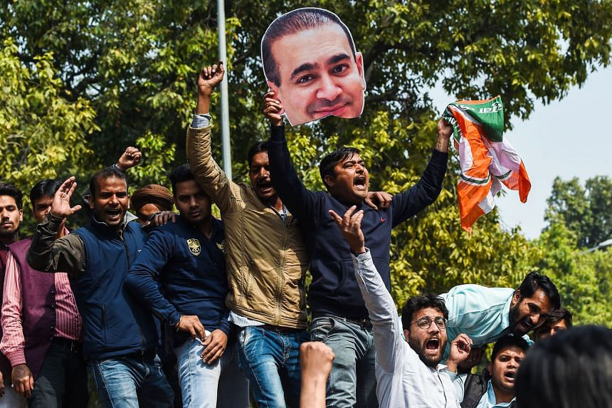 Supporters of India's Congress Party staging a protest against billionaire jeweller Nirav Modi in New Delhi last year.