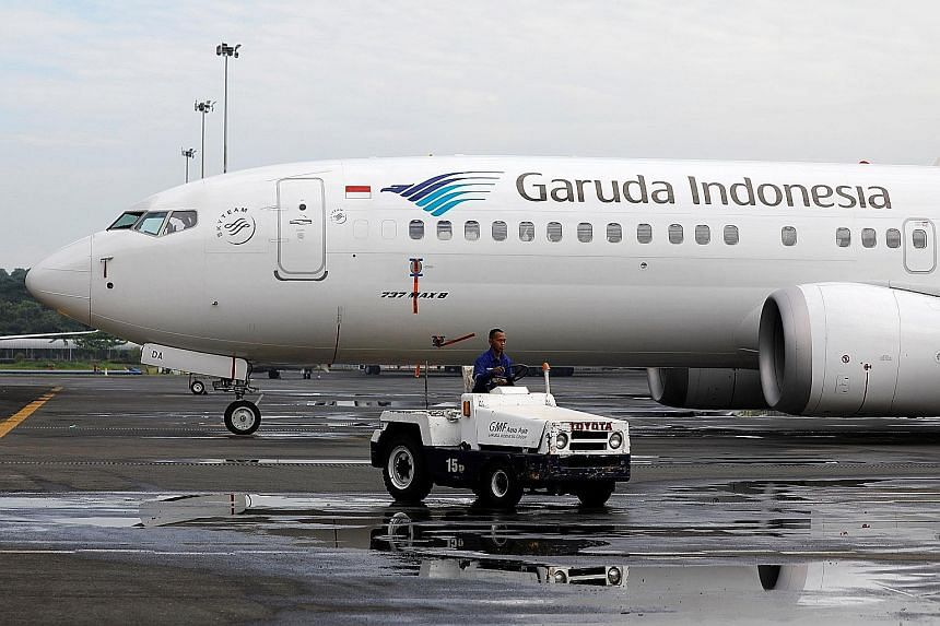 A Garuda Boeing 737 Max 8 parked at the Garuda maintenance facility at the Soekarno-Hatta airport near Jakarta last week. The Indonesian carrier's move to cancel its order could spark more cancellations from other major carriers.