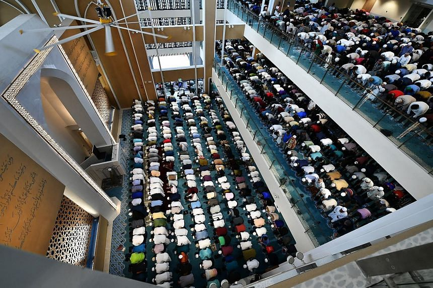 "Muslims praying at the Masjid Darul Ghufran in Tampines yesterday. Imams across Singapore underscored the importance of forgiveness in Friday prayer sermons, saying: ""Extending forgiveness to those who have hurt us is far more powerful than any bulle"