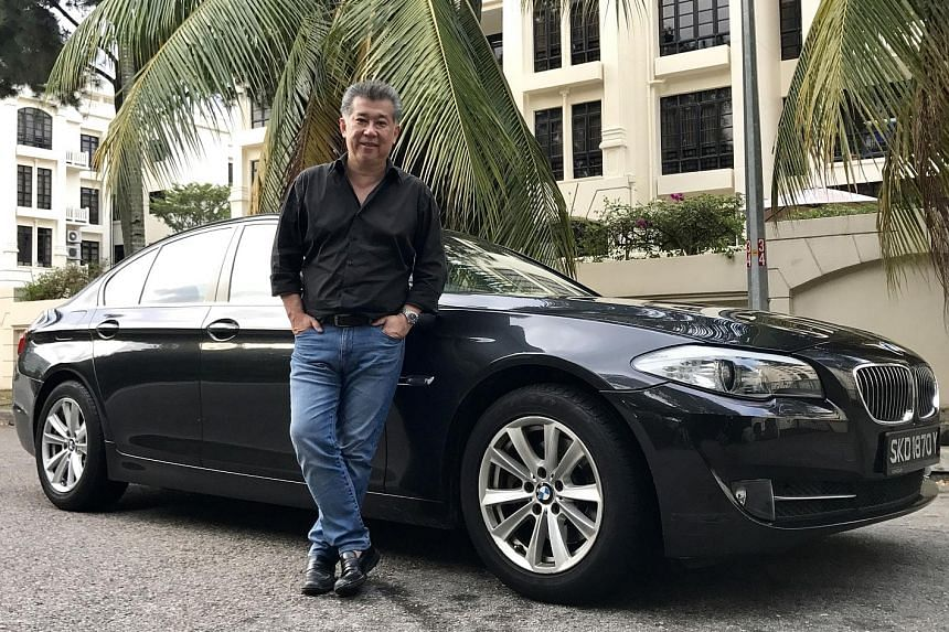 Mr Rene Tan appreciates how easy it is to drive and park the BMW 523i, which is equipped with parking sensors and reverse camera.