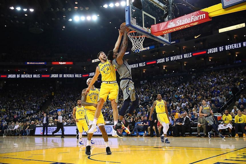 Golden State Warriors guard Klay Thompson rising to block Indiana Pacers guard Tyreke Evans' attempt in their National Basketball Association game at the Oracle Arena on Thursday. Thompson finished with 18 points in Golden State's 112-89 win.