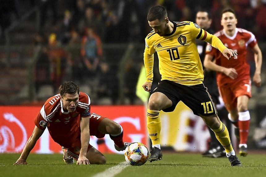 Belgium captain Eden Hazard giving Russia's Kirill Nababkin the slip during their Euro 2020 qualifying match in Brussels, which the hosts won 3-1.