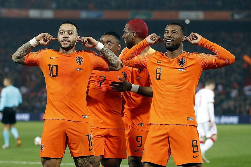 """The Netherlands' (from left) Memphis Depay, Steven Bergwijn, Ryan Babel and Georginio Wijnaldum """"ignoring"""" the applause during their 4-0 win over Belarus in a Euro 2020 qualifier in Rotterdam on Thursday."""