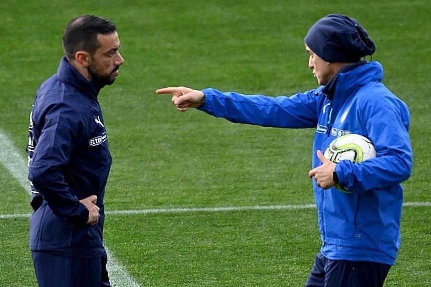 Italy coach Roberto Mancini instructing Fabio Quagliarella during training ahead of the Euro qualifiers against Finland and Liechtenstein.