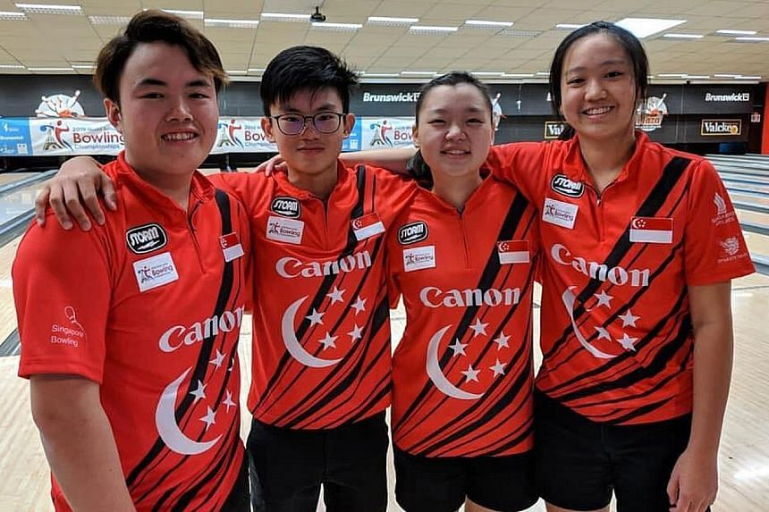 Singapore's mixed quartet of (from left) Xavier Teo, Eugene Yeo, Quek Lu Yi and Arianne Tay won a bronze medal at the World Junior Bowling Championships in France on Thursday. They had qualified for the semi-finals in second place with 5,477 pinfalls