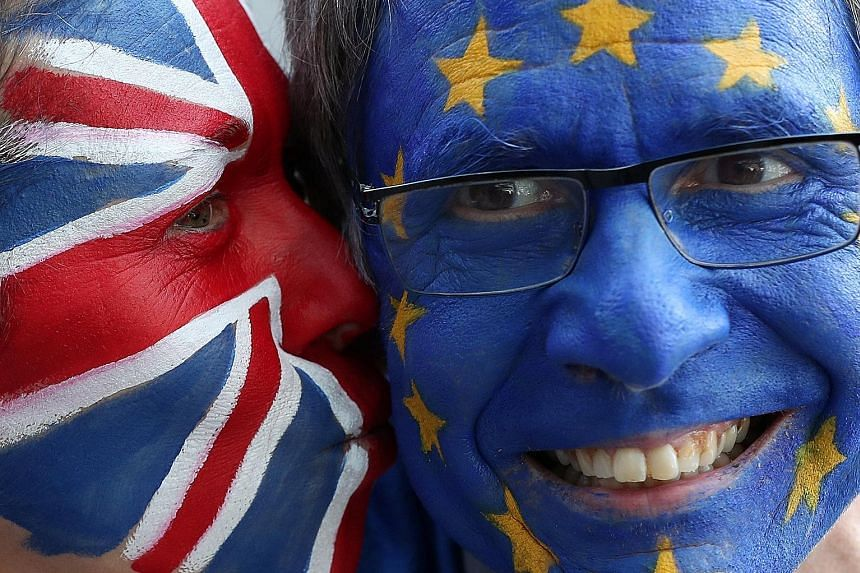 Protesters with European Union and British flags painted on their faces seen ahead of an EU summit in Brussels, Belgium, on Thursday.