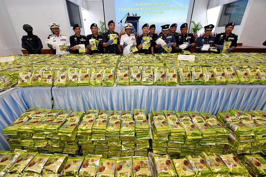 Malaysian drug busters with the seized 2,060kg of drugs believed to be syabu, or crystal methampheta-mine, disguised as Chinese tea.