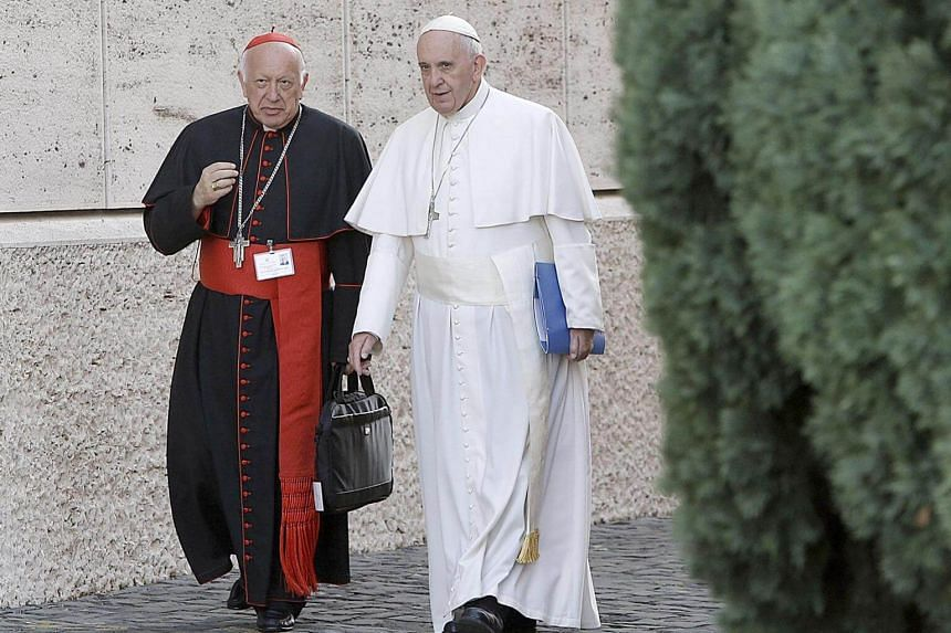 Cardinal Ricardo Ezzati (left) with Pope Francis at the Vatican City, on Oct 5, 2015. Despite his resignation as archbishop of the Chilean capital, Ezzati will keep his title of cardinal.