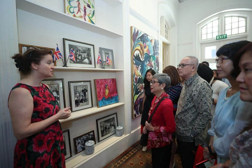 Mrs Anne Wightman (left), wife of British High Commissioner to Singapore Scott Wightman, taking the guests on a tour of the Garden Room at the Eden Hall.