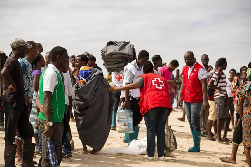 Survivors of Cyclone Idai, cut off by flood water, arrive by rescue boat to an evacuation centre in Beira, Mozambique, on March 21, 2019.