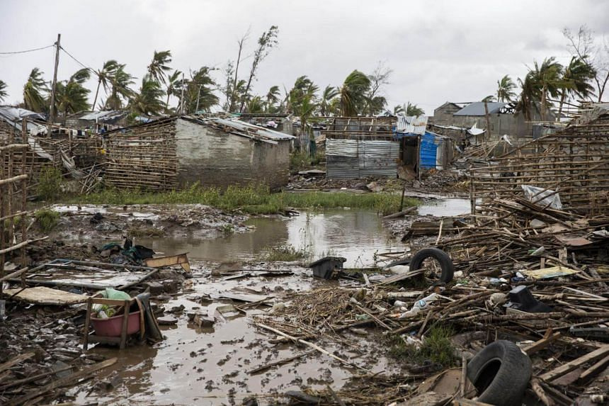 Flood water covers the ground between rubble where there once use to be houses at an informal settlement in Beira, the fourth largest city in Mozambique, on March 23, 2019.