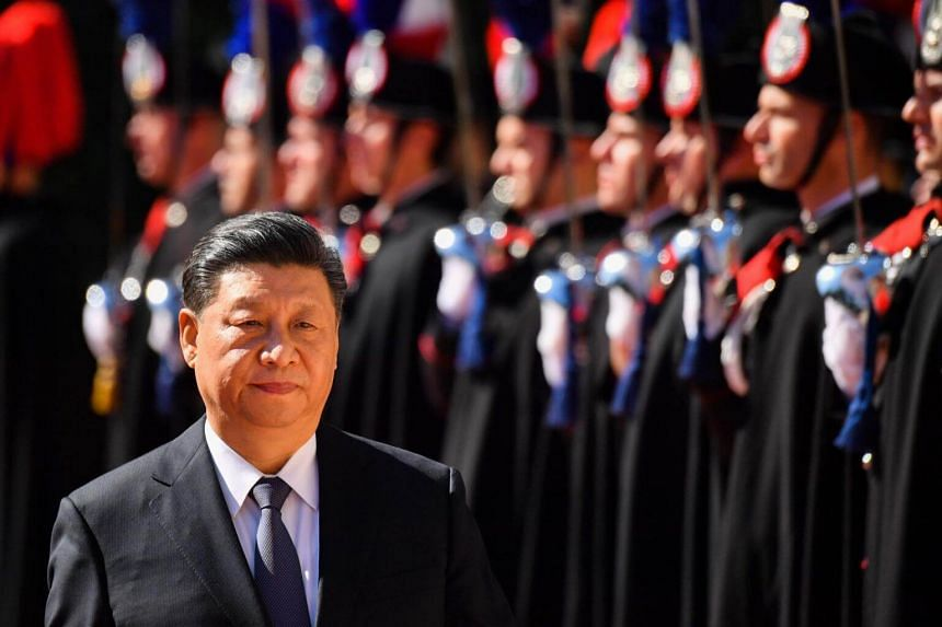 China's President Xi Jinping reviews Italian Carabinieri during a welcoming ceremony upon his arrival for a meeting with Italy's Prime Minister at Villa Madama in Rome, on March 23, 2019.