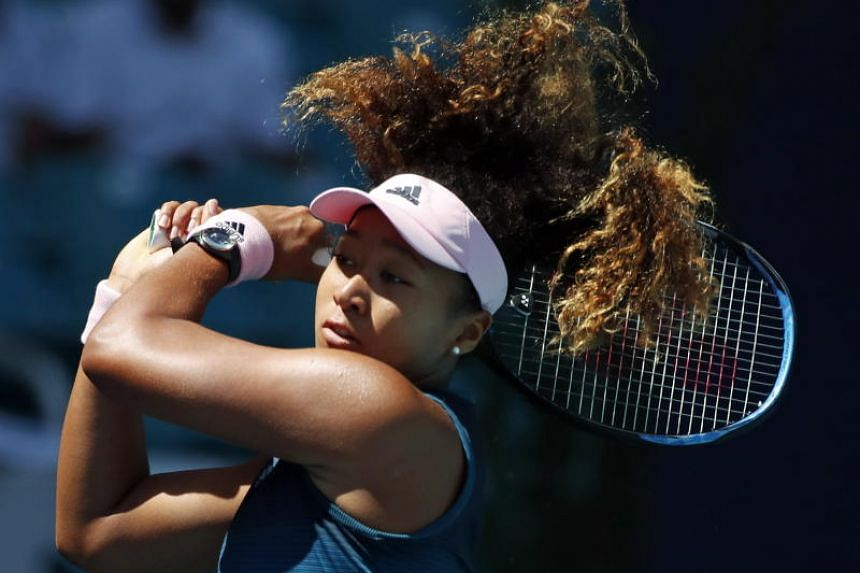 Naomi Osaka of the Japan in action against Yanina Wickmayer of Belgium during their match at the Miami Open tennis tournament in Miami, Florida, on March 22, 2019.