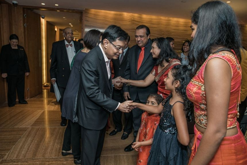 Finance Minister Heng Swee Keat interacting with Mrs Indra Iswaran's family members after speaking at the launch of her book, They Came From Jaffna, on March 23, 2019.