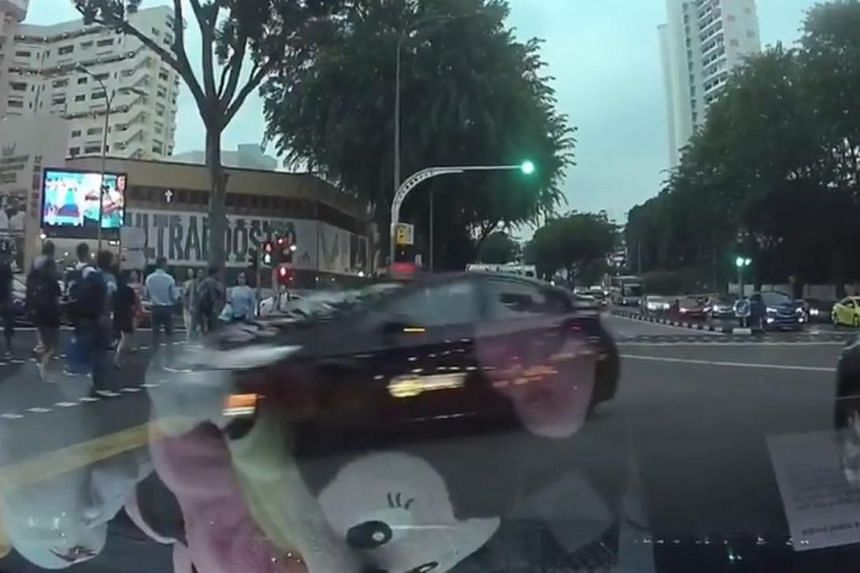 A video posted on Facebook shows the taxi driver beating the red light and abruptly making a right turn.