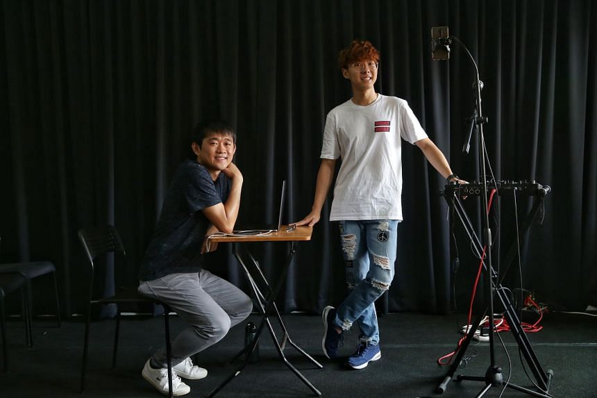 Busker and SIM student Yee Kien (right), is working with Toy Factory Production's associate artistic director Stanley Seah (left) on a performance about buskers in Singapore, on March 21, 2019.