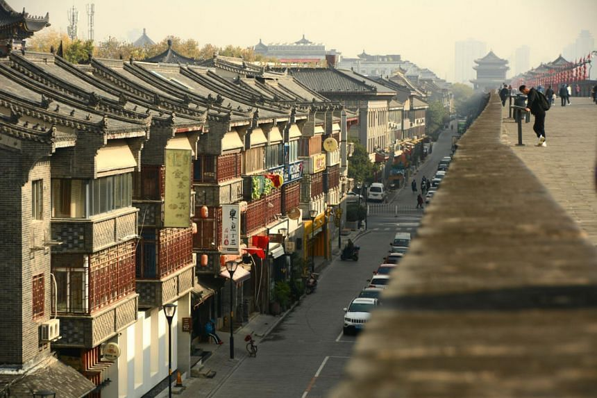 Rising some 12m above the ground and stretching 14km round the city, Xi'an's 600-year-old city wall gives a good view of the older parts of the city below. The top spans more than 10m wide, accommodating cyclists, runners and walkers all at once.