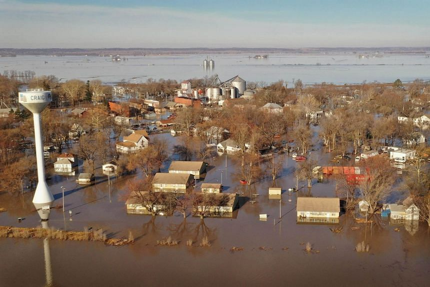 Floodwater surrounds the town in Craig, Missouri on March 22, 2019.