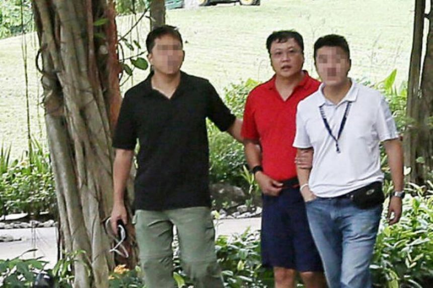 The prosecution is seeking to establish that Leslie Khoo Kwee Hock (in red) had bought charcoal on the night of July 12, 2016, after killing engineer Cui Yajie that morning.