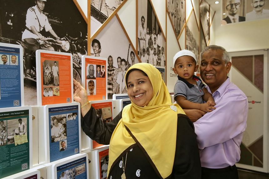 (From left) Madam Mumtaj Bivi, husband Naseer Ghani and grandson Arfan Hassan Ghani bin Anwar pose with old photos of her parents and ancestors at the Nagore Dargah Indian Muslim Heritage Centre.
