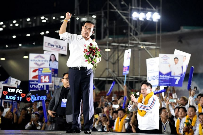 Thailand's junta leader and Phalang Pracharat party's candidate for prime minister Prayut Chan-o-cha gestures during the party's final major campaign rally in Bangkok, on March 22, 2019.