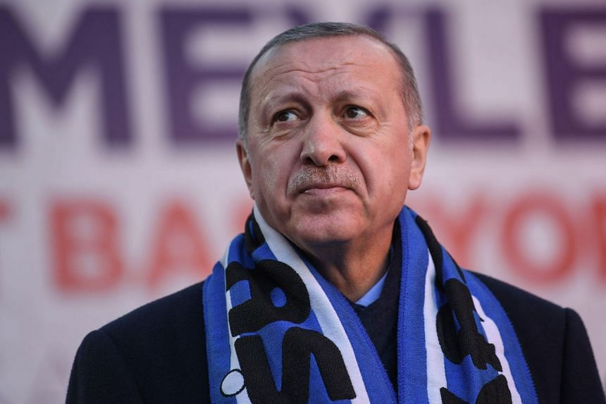 Turkish President Recep Tayyip Erdogan looks on as he addresses his Justice and Development Party (AK Party) local election rally at Istanbul's Kasimpasa district, on March 5, 2019.