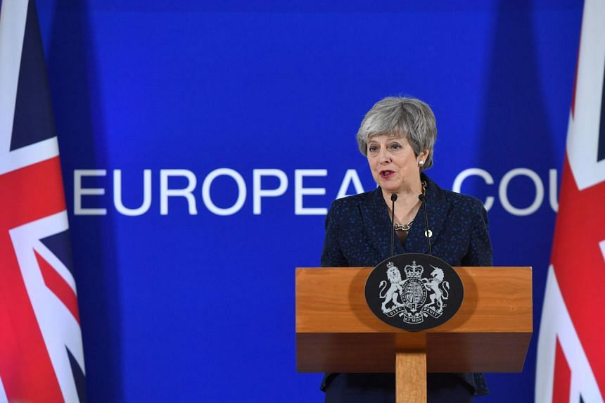 British PM Theresa May speaks on the first day of an EU summit focused on Brexit, in Brussels, on March 21, 2019.