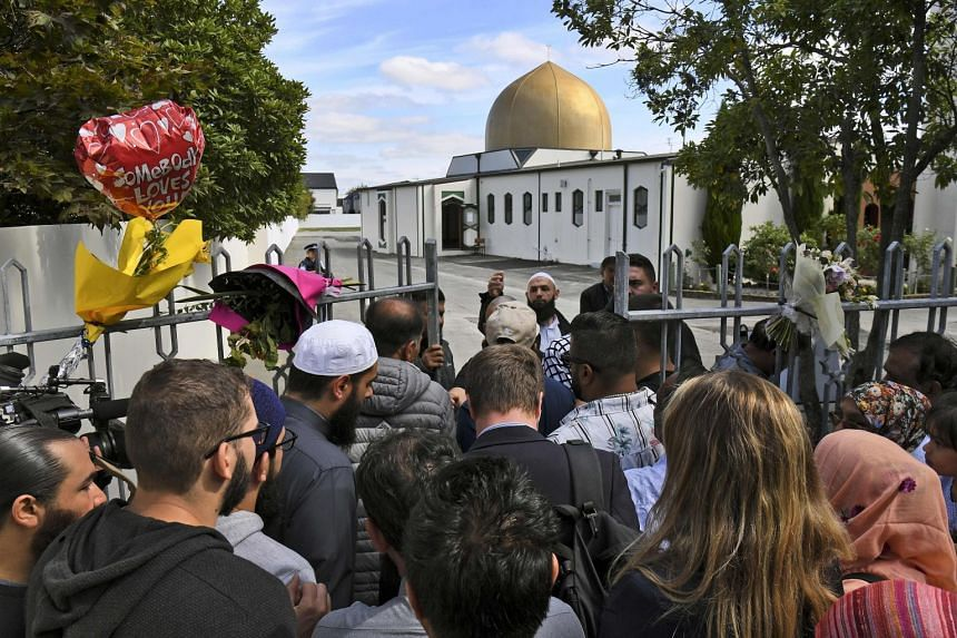 People at the gates of the Al Noor mosque after it was reopened in Christchurch, on March 23, 2019.