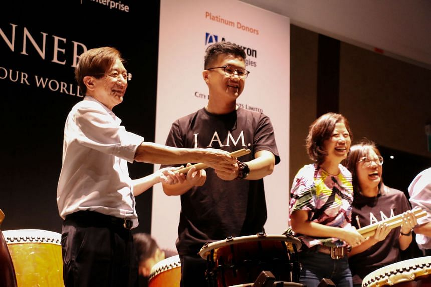 (From left) Former top public servant Philip Yeo with Philip Yeo Initiative (PYI) grant recipient Wang Junyong, founder of Mangrove Learning, and PYI steering committee member Aw Kah Peng with Ms Debra Lam, founder of Society Staples, during the Taik