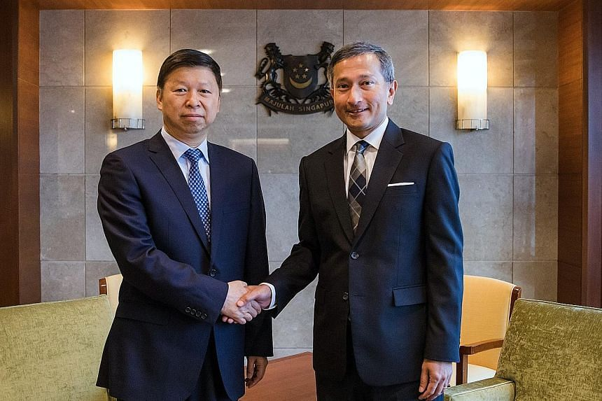 Chinese Communist Party's Minister of the International Department Song Tao, in Singapore on a four-day visit, meeting Foreign Minister Vivian Balakrishnan at the Ministry of Foreign Affairs yesterday.