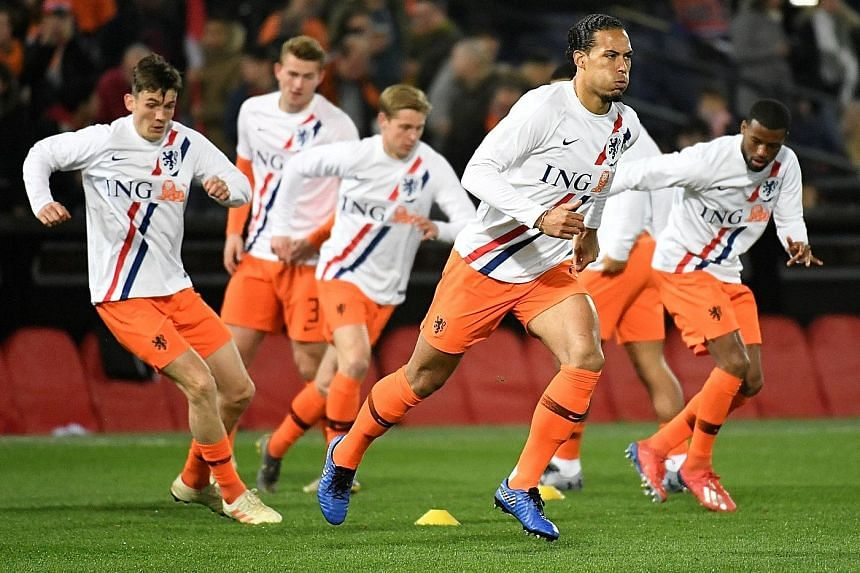 Virgil van Dijk (in front, warming up for the Belarus match on Thursday) says that while the Netherlands played well in beating Belarus 4-0, they can be a lot better against Germany today.