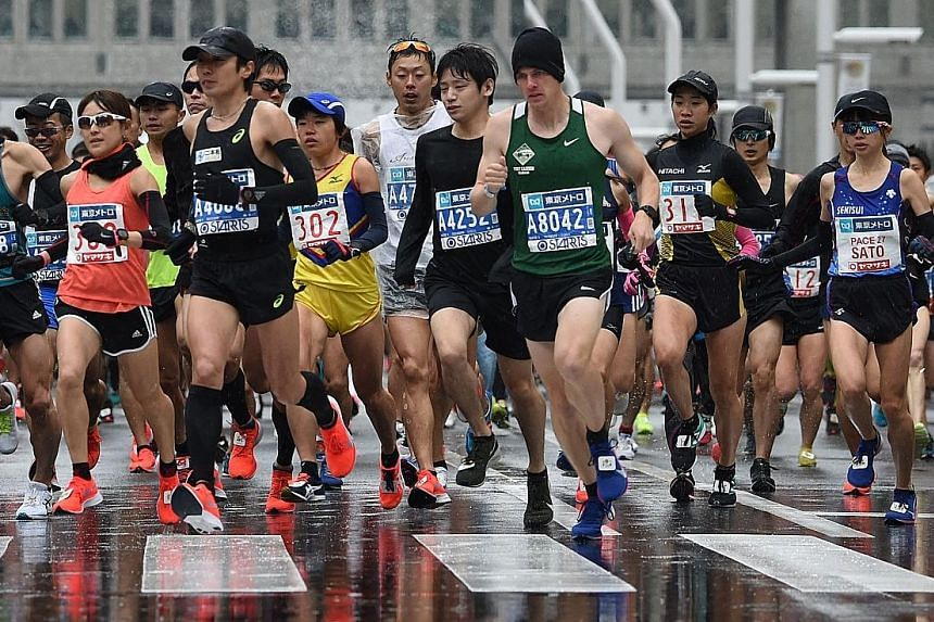 Runners at the start of the Tokyo Marathon earlier this month. New reviews indicate that exercise can equal or exceed the effects of drugs on high blood pressure and visceral fat.
