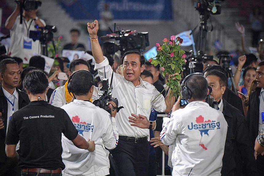 Thailand's Prime Minister Prayut Chan-o-cha, who is Palang Pracharath's sole candidate for premier, at the party's last major rally, in Bangkok on Friday, ahead of the election today.