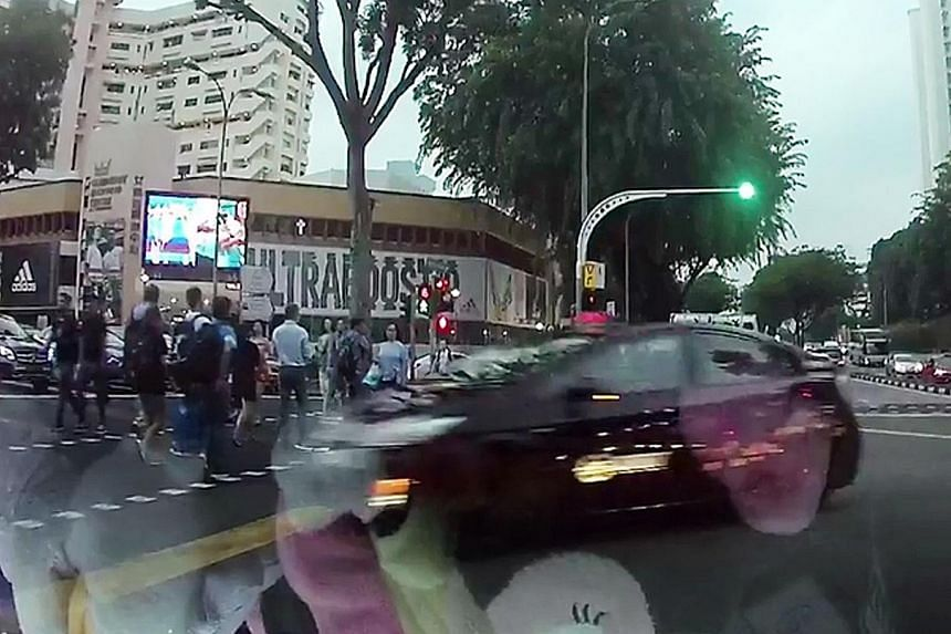 A video posted on Facebook page SG Road Vigilante shows that the taxi changed lanes before making a right turn at the junction of Jalan Bukit Merah and Alexandra Road, crossing the path of oncoming vehicles on Friday evening.