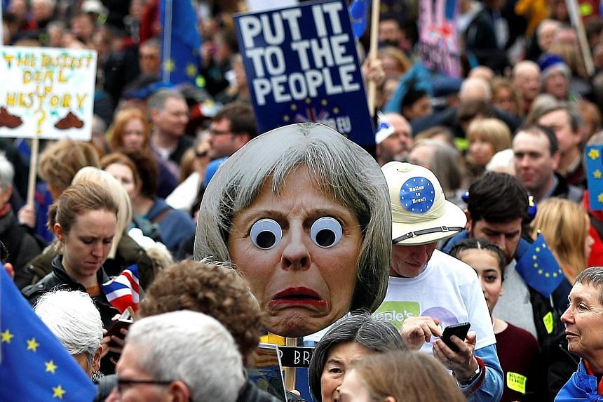 """Pro-EU demonstrators in the """"People's Vote"""" march in London yesterday. Organisers said hundreds of thousands of people were in the crowd as it began to march."""