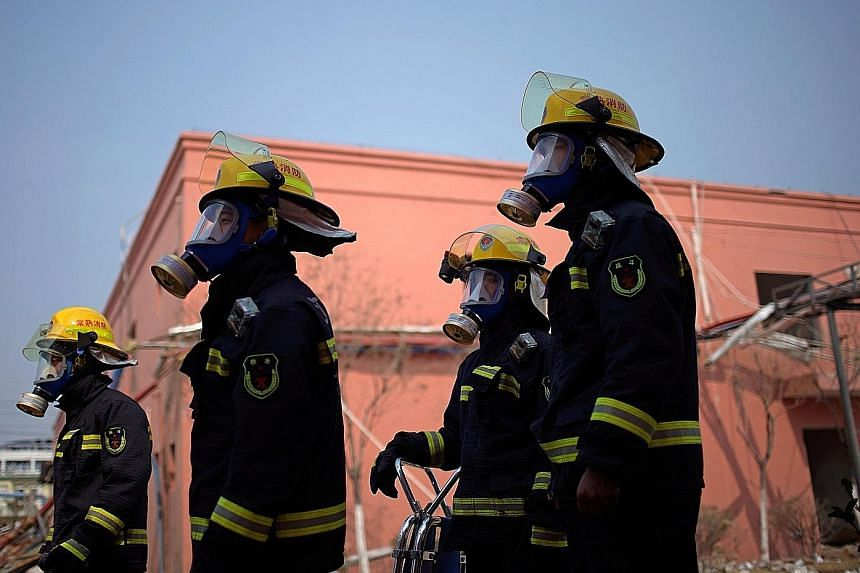 Firefighters at the pesticide plant following the massive explosion in Yancheng last Thursday. People looking for a missing relative in the rubble at the pesticide plant owned by Tianjiayi Chemical. The company had been cited and fined for work safet