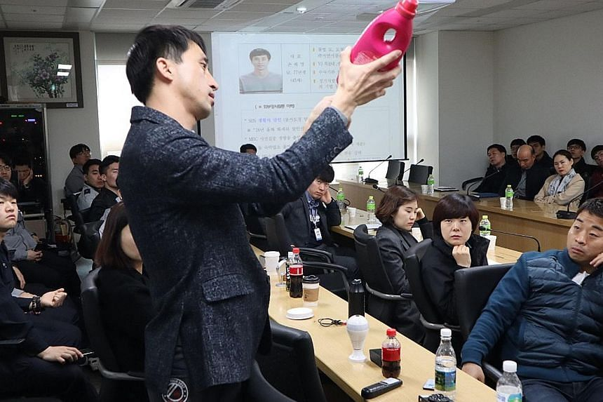 Mr Son Hae-young, an expert at detecting spycam and tapping, is seen here conducting a class for police officers on how to discover hidden cameras. His team of 11 handles 200 cases a month. His clients are mostly women in their 20s and 30s who live a