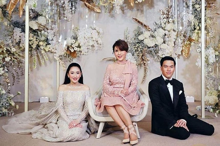 The bride and groom with her father Thaksin Shinawatra and aunt Yingluck. The wedding took place at the Rosewood Hotel in Hong Kong's Victoria Dockside area, overlooking Kowloon's waterfront. The newly-weds with Thailand's Princess Ubolratana Rajakan